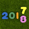 Numeral 2017 - 2018 on green grass Royalty Free Stock Photo