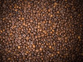 Numerous coffee beans which have been scattered all over the surface Royalty Free Stock Image