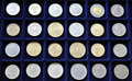 Numismatic coin collection of coins on blue mat Stock Photography