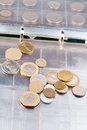 Numismatics album with different coins Stock Photography