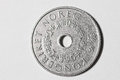 Numismatics norwegian coin with a hole Royalty Free Stock Image
