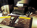 Numismatics white desk with typewriter telephone lamps and files an opened file shows several currencies of different countries of Royalty Free Stock Photography