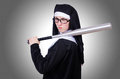 Nun with baseball bat on white Stock Images