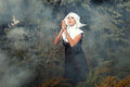 Nun folded her arms beautiful glamorous across chest she among the smoke outdoors Stock Photo