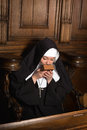 Nun kissing prayer book young an old after praying shot in a th century church interior Royalty Free Stock Images