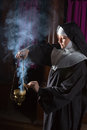 Nun preparing incense for mass young an burner Royalty Free Stock Photography