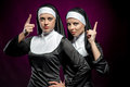 Nuns attractive young posing indoors Stock Photography
