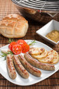 Nuremberg sausages or Bratwurst on plate. Royalty Free Stock Photo