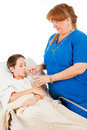 Nurse Administers Fluids Stock Photo