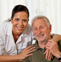Nurse in aged care for the elderly in nursing Royalty Free Stock Photos