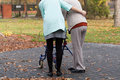 Nurse and disabled with walker on the outside Stock Photos