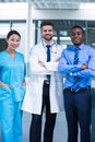 Nurse and doctor with businessman standing in hospital Royalty Free Stock Photo