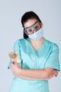 Nurse or doctor in pilot glasses with mask and money over gray background corruption concept Royalty Free Stock Photography