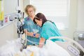 Nurse giving nitroud oxide mask to pregnant woman mature female nitrous women in active labor Stock Photography
