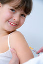 Nurse giving vaccination injection to little girl Royalty Free Stock Images