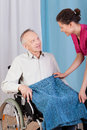 Nurse helping disabled man men in a hospice Royalty Free Stock Images
