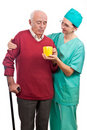 Nurse helping disabled senior tea cup Stock Image
