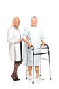 Nurse helping a patient to use a walker Stock Photography