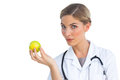 Nurse holding apple Royalty Free Stock Photo