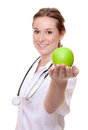 Nurse holding green apple Royalty Free Stock Photo