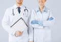Nurse and male doctor holding cardiogram picture of Royalty Free Stock Images