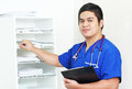 Nurse and the medical records handsome male asian working on Royalty Free Stock Images