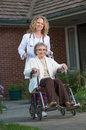 Nurse Push Senior on Wheelchair Outdoor Stock Photo