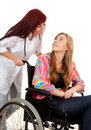 Nurse is pushing her patient on a wheelchair Stock Photography