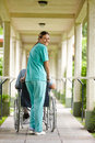 Nurse pushing senior man Stock Images
