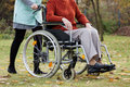 Nurse pushing wheelchair Royalty Free Stock Image