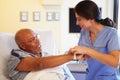 Nurse Putting Wristband On Sen...