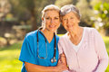 Nurse senior patient mid age medical and outdoors Stock Images