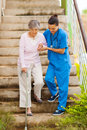 Nurse senior stairs Royalty Free Stock Images