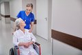 Nurse with senior woman in wheelchair at hospital Royalty Free Stock Photo