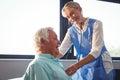 Nurse using stethoscope to take care of a senior man Royalty Free Stock Photo