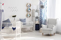 Nursery with white chair and cradle Royalty Free Stock Photo
