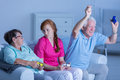 Nursing home residents playing together Royalty Free Stock Photo