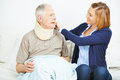Nursing service checking ruff of senior man men in home Stock Image