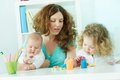 Nurture pretty women spending time with her children at home Stock Photo