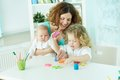 Nurture pretty women spending time with her children at home Stock Images