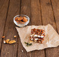 Nut bar with nuts on wooden table Stock Photo