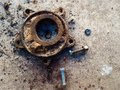 Nut and old metal equipment on dirty ground after used in work hard for a long time