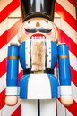 Nutcracker typical wooden figure which breaks the nuts using lever technology in its mouth Royalty Free Stock Photo