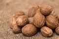 Nutmeg on a burlap sack Stock Images