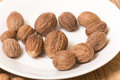 Nutmeg on a white plate Royalty Free Stock Image