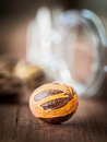 Nutmeg whole on a wooden table Stock Images
