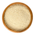 Nutritional yeast flakes in wooden bowl over white Royalty Free Stock Photo