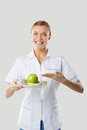 Nutritionist holding hands apple and measuring green Royalty Free Stock Photography