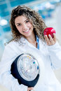 Nutritionist holding weight scale a and an apple healthy lifestyle Royalty Free Stock Photo