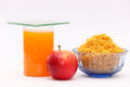 Nutritious breakfast apple and fruit juice a fresh red glass of orange some light fried snacks for a collection of food articles Stock Photography
